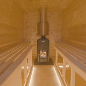 The sauna has space for up to 6 persons and warm LED ambient lights.