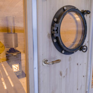 The porthole Sauna is installed on a trailer with Harvia wood oven and hot water tank.